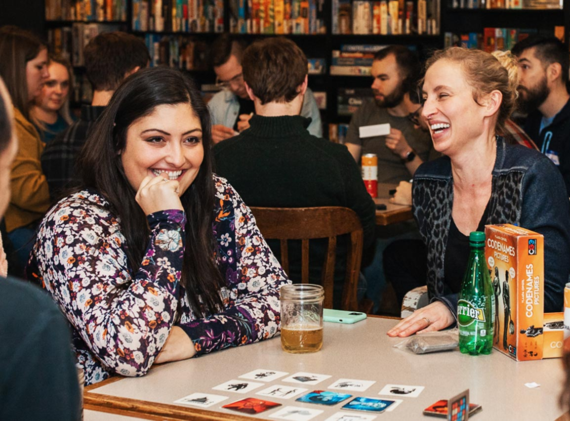 Friends laughing and having fun playing CODENAMES